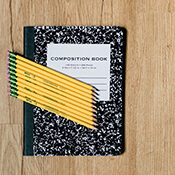 composition notebook and pencils